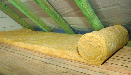 A roll of ordinary loft insulation partially unrolled