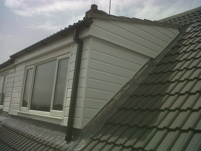 flashing visible on a concrete profiled tile roof and dormer window