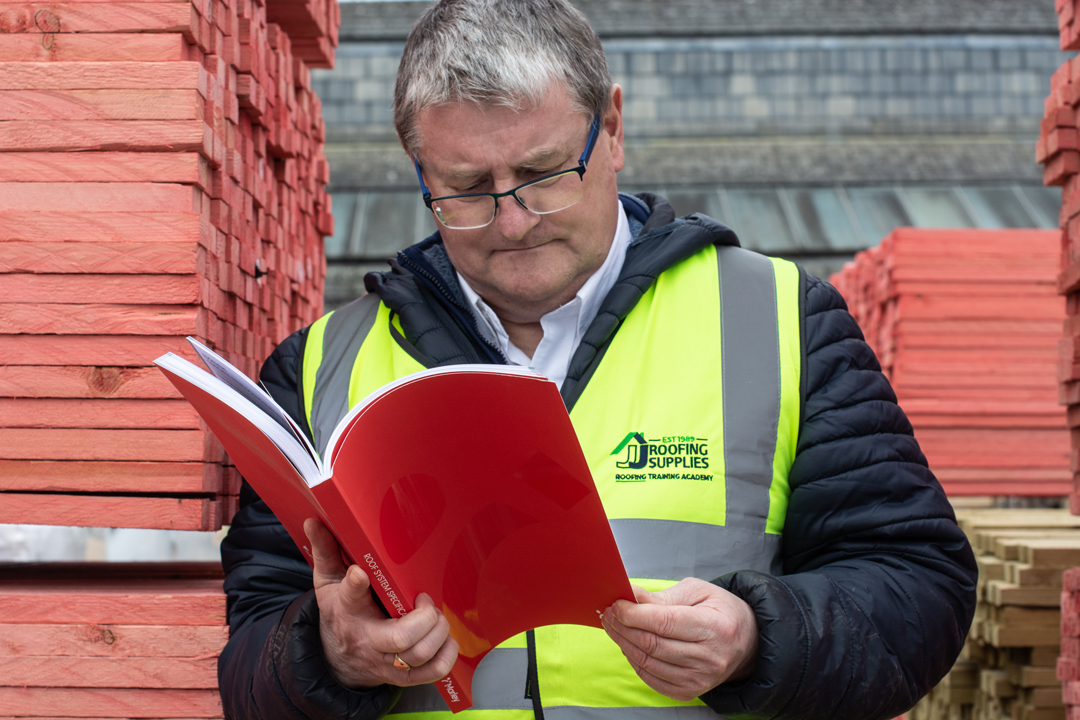 Steve front on holding his favourite roofing literature, the Marley Roof System Specification Guide