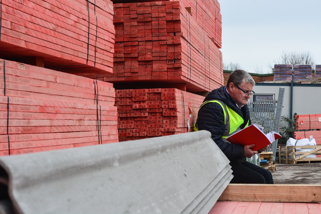 Steve sitting reading his favourite roofing literature, the Marley Roof System Specification Guide